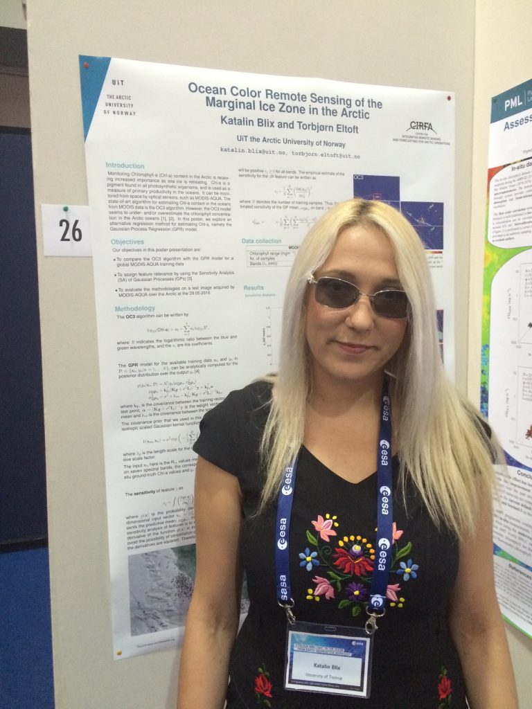Katalin Blix in front of her poster at the CLEO conference.