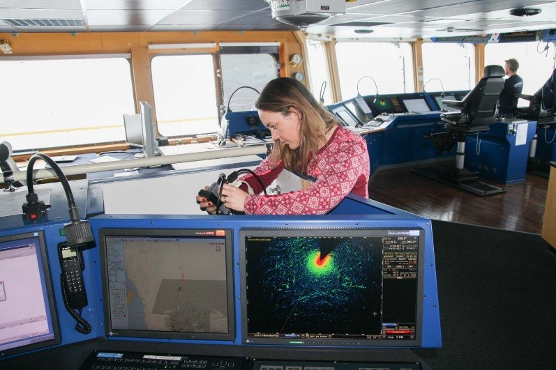 Figure 2 Skarbø checking the display cable connection between the radar operator station and her equipment, during the Arctic Ocean 2016 research cruise.